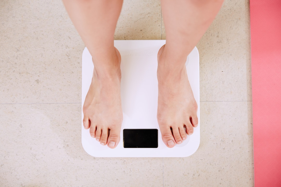 Weighing In | Woman's legs on scale for weight