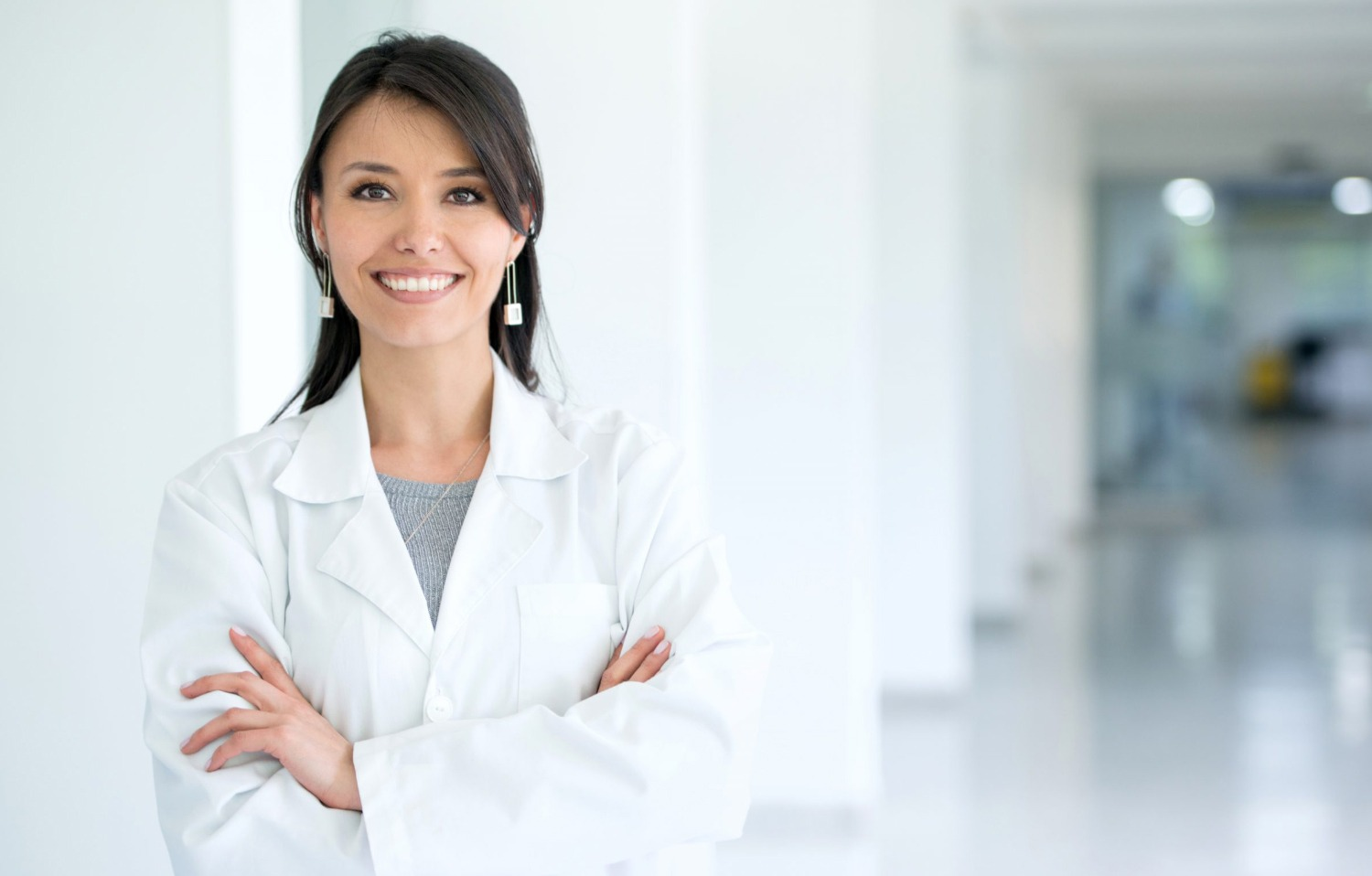 Doctor with crossed arms posing in hallway | Diagnose Your Practice