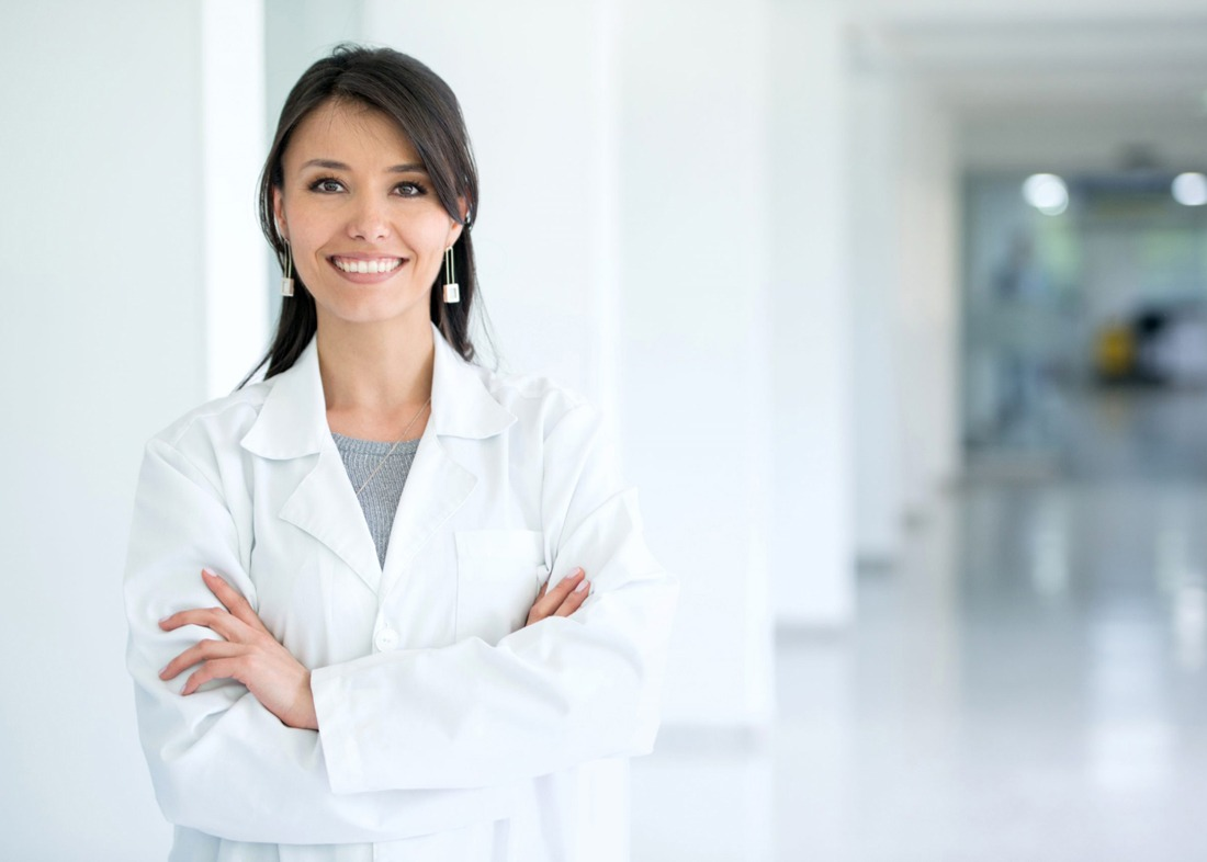 Doctor with crossed arms posing in hallway